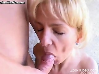 Married blonde decides to blow a brown bulldog