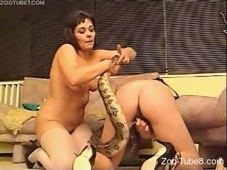 Two horny housewives in a threesome with a snake