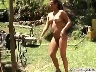 Good-looking brunette blows a horse before fucking it