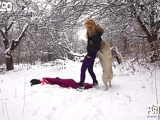 Outdoor fucking video with a blonde and her kinky dog