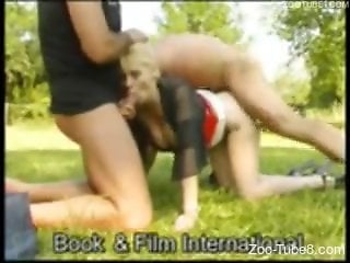 Blond-haired bitch fucking a stallion outdoors