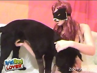 Masked zoophile stroking a dog's delicious boner