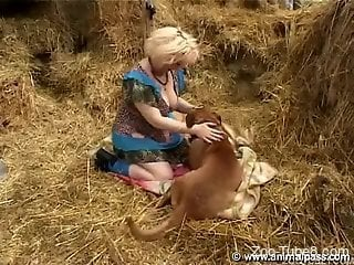Busty zoophile lady getting fucked by a pooch