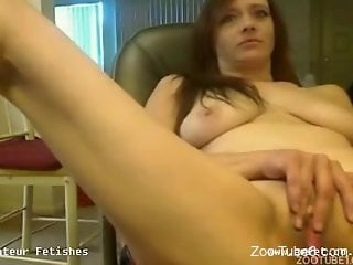 Zoophilic beauty lets a dog eat her gorgeous pussy